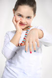 Little girl showing her colourful nails. Closeup Stock Image