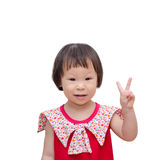 Little girl showing her hand means victory Royalty Free Stock Photography