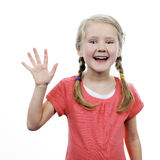 Little girl showing her hand up Stock Images