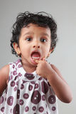 A little girl showing her teeth Royalty Free Stock Images