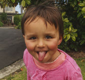 Little girl showing her tongue and her character, photo took in New Zealand, photo is usable on picture post card, calendar, garde Stock Photography