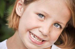 Little girl showing her white teeth Royalty Free Stock Photography