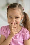 Little girl showing hush sign Royalty Free Stock Photo