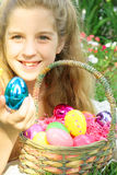 Little girl showing off Easter eggs Stock Images