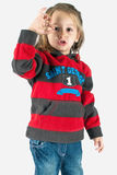 Little girl showing ok sign. In studio isolated on white background Stock Image