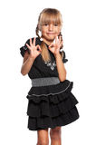 Little girl showing ok sign. Happy little girl showing ok sign, isolated on white background Stock Photography