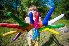 Little girl showing painted hands, focus on hands. Hand prints. Art and painitng concept royalty free stock photography