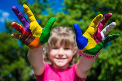 Little girl showing painted hands, focus on hands. Hand prints. Art and painitng concept royalty free stock images