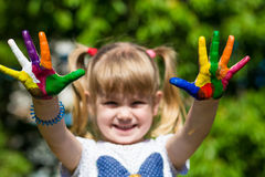 Little girl showing painted hands, focus on hands. Hand prints. Art and painitng concept royalty free stock photo