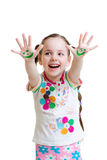 Little girl showing painted hands with funny face Stock Image