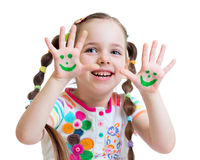 Little girl showing painted hands with funny face Royalty Free Stock Images