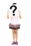 Little girl showing question mark sign on papaer Stock Image
