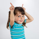 Little girl showing rabbit ears Royalty Free Stock Photography