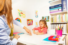 Little girl showing small man with her fingers Royalty Free Stock Photo
