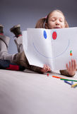 Little girl showing a smile drawn Stock Photo