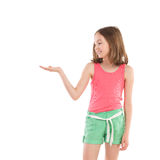 Little girl showing something on the open palm Royalty Free Stock Photos