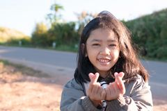 A little girl showing symbol of miniheart royalty free stock photography