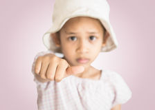 Little girl showing thumb Royalty Free Stock Photos