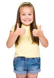 Little girl is showing thumb up gesture Stock Photos