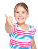 Little girl is showing thumb up gesture. Over white Royalty Free Stock Photography
