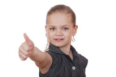 Little girl is showing thumb up gesture using both hand Stock Photos