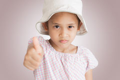 Little girl showing thumb up Stock Photography