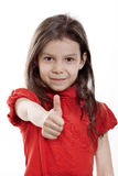 Little girl showing thumb. On white background stock photo