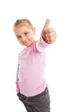 Little girl showing thumbs up. Stock Images