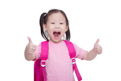 Little girl showing thumbs up and smiles Stock Photo