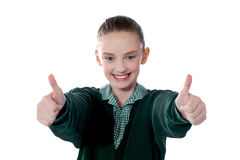 Little girl showing thumbs up to camera Stock Photos