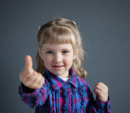 Little girl showing thumd up Stock Photo