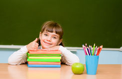 Little girl showing thums up on the background of chalkboard Stock Photography
