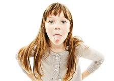 Little girl showing the tongue royalty free stock photos