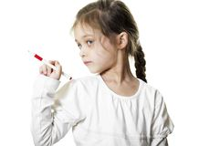 Little girl shows  ballpoint pen. Little girl with blue eyes shows  ballpoint pen Stock Images