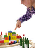 Little girl shows blocks city Royalty Free Stock Image