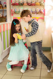 Little girl shows boy how to use tablet. Little girl shows boy how to use the tablet. Happy kids looking at the tablet Royalty Free Stock Photography
