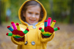 Little girl shows colored woolen Stock Photo