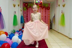 Little Girl Shows Dress And Having Fun Stock Images