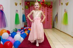 Little Girl Shows Dress And Having Fun Royalty Free Stock Photography
