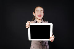 Little girl shows empty screen of white Digital Tablet Royalty Free Stock Image