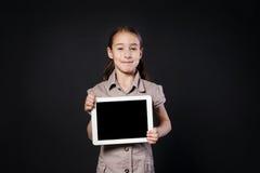 Little girl shows empty screen of white Digital Tablet Stock Photo