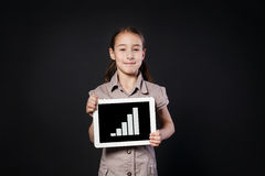 Little girl shows empty screen of white Digital Tablet Stock Photos