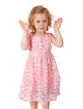 Little girl shows a face from the hands Stock Images