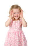 Little girl shows a face from the hands Royalty Free Stock Photos
