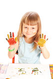 Little girl  shows the hand painted colors. Little girl sitting at a table and shows the hand painted colors Stock Photography