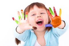 Little girl shows her colored hands Stock Images
