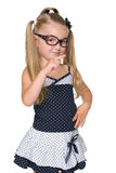 Little girl shows her forefinger to the side Stock Photos