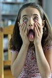 Little Girl with Scary Face Stock Image