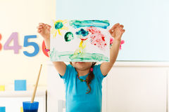 Little girl shows her painting Stock Photography