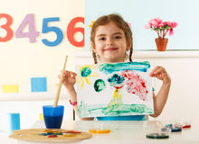 Little girl shows her painting Royalty Free Stock Photos
